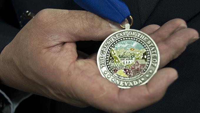 Master Sgt. Paul Hinen shows off his Drennan A. Clark-Order of Nevada medal April 2, 2017 at Nevada Air National Guard Base, Reno, Nev.